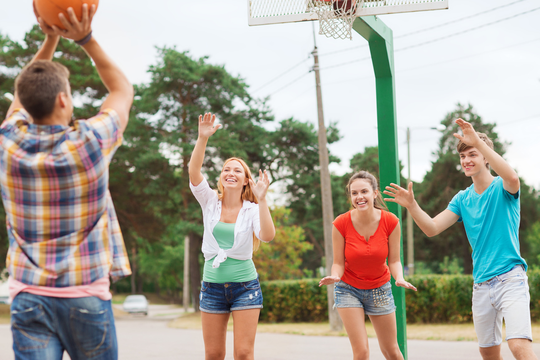 photodune-9528557-group-of-smiling-teenagers-playing-basketball-m